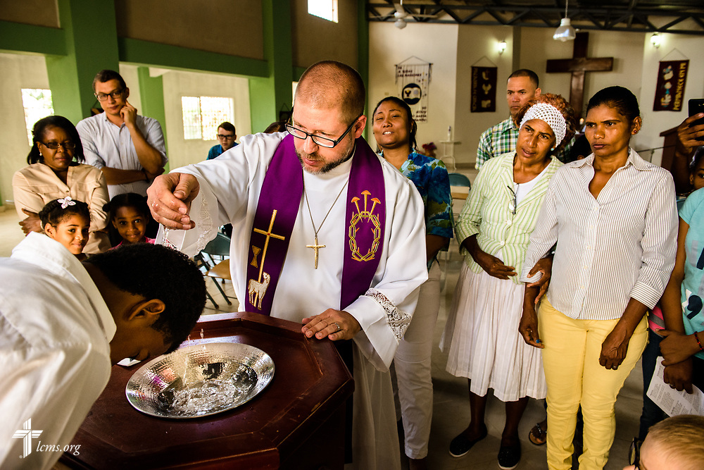 The Rev. Joel Fritsche, LCMS career missionary to the Dominican Republic, baptizes Starling Mendez during worship on Sunday, March 19, 2017, at Amigos de Cristo Iglesia Luterana in Las Americas (Friends of Christ Lutheran Church in the Americas) in Santo Domingo, Dominican Republic. LCMS Communications/Erik M. Lunsford