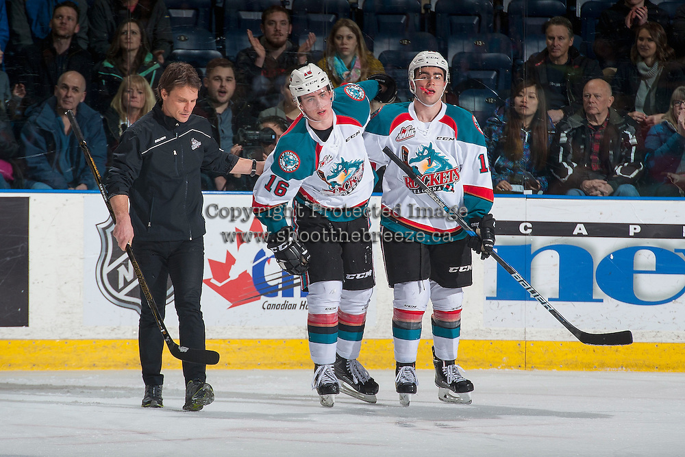 KELOWNA, CANADA - FEBRUARY 1: Kelowna Rockets' athletic therapist Scott Hoyer, and Dillon Dube #19 assist Kole Lind #16 of the Kelowna Rockets to the bench after a check into the boards by the Calgary Hitmen the on February 1, 2017 at Prospera Place in Kelowna, British Columbia, Canada.  (Photo by Marissa Baecker/Shoot the Breeze)  *** Local Caption ***