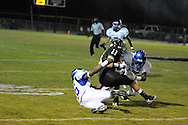 Water Valley's K.J. Lee (17) and Water Valley's C.J. Jackson (26) make a tackle vs. Mooreville in Mooreville, Miss. on Friday, September 30, 2011. Water Valley won 21-20 in overtime.