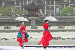 Models present creations of She ethnic group during an outdoor fashion contest held at Jingning She Autonomous County in Lishui, east China's Zhejiang Province, April 9, 2016. EXPA Pictures © 2016, PhotoCredit: EXPA/ Photoshot/ Li Suren<br /> <br /> *****ATTENTION - for AUT, SLO, CRO, SRB, BIH, MAZ, SUI only*****
