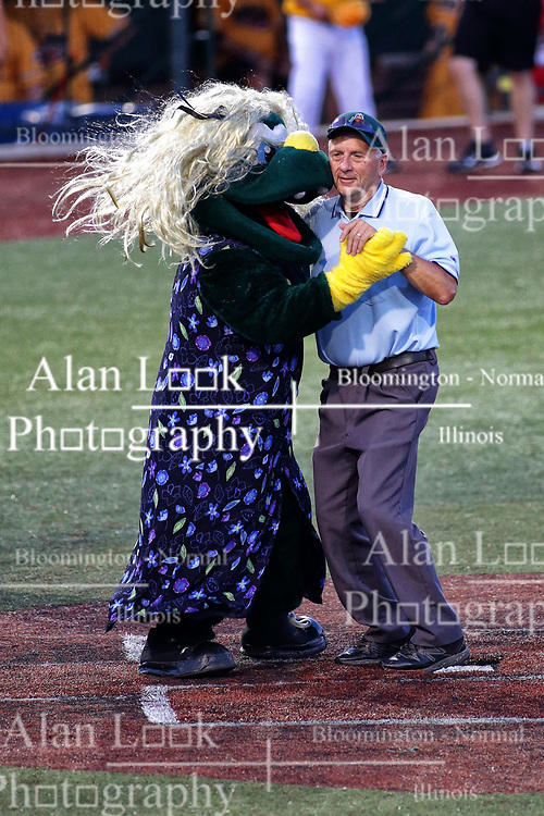 04 August 2018: Corny dances with the home plate umpire. Legends Game for the Miracle League at Corn Crib Stadium on the campus of Heartland Community College in Normal Illinois<br /> <br /> Game featured retired MLB players from the ST. Louis Cardinals and the Chicago Cubs...  Derek Lee, Bobbie Dernier, Kyle Farnsworth, Les Lancaster, Ray Lankford, Kerry Robinson, Jim Edmonds, and Aramis Ramirez