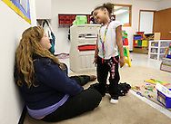 Zaria Larsen (right), 3, of Cedar Rapids shows the necklace she made to Amanda Kepler, of Marengo, at Building Blocks Child Care in Cedar Rapids on Wednesday February 25, 2009.  (Stephen Mally/Freelance)