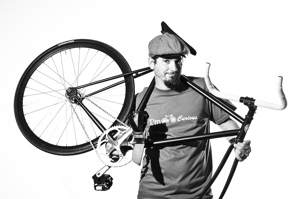 Cyclist holding bicycle, Veloreviews, Velobrews, San Francisco by Pettepiece Headshots, Pettepiece Commercial Photography, Olympia, Tacoma, Seattle, Portland.