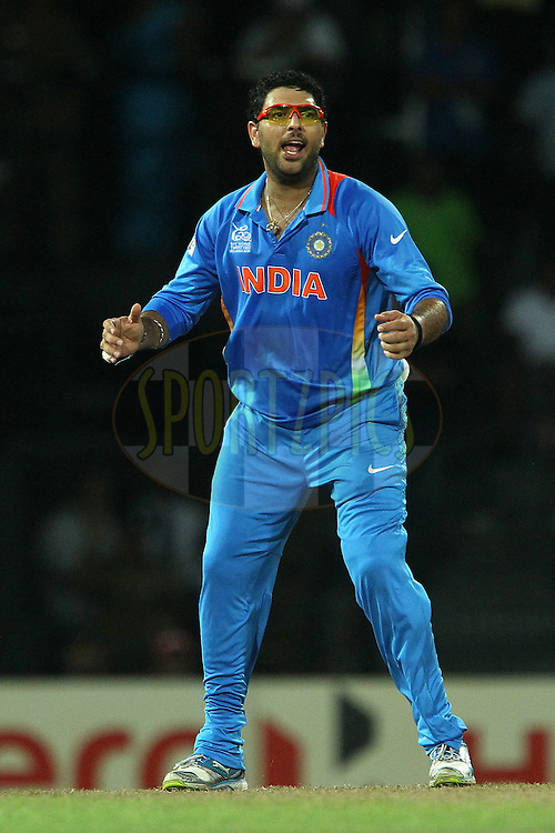 Yuvraj Singh reacts after bowling during the ICC World Twenty20 Super 8s match between Australia and India held at the Premadasa Stadium in Colombo, Sri Lanka on the 28th September 2012..Photo by Ron Gaunt/SPORTZPICS