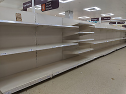 At Sainsbury's supermarket in Clapham, London, shoppers had cleaned out many products in panic buying over COVID-19.
