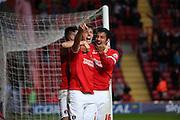 Charlton Athletic defender Morgan Fox celebrating with the fans after Charlton scored their third goal to take the score 3-0 during the Sky Bet Championship match between Charlton Athletic and Sheffield Wednesday at The Valley, London, England on 7 November 2015. Photo by Matthew Redman.