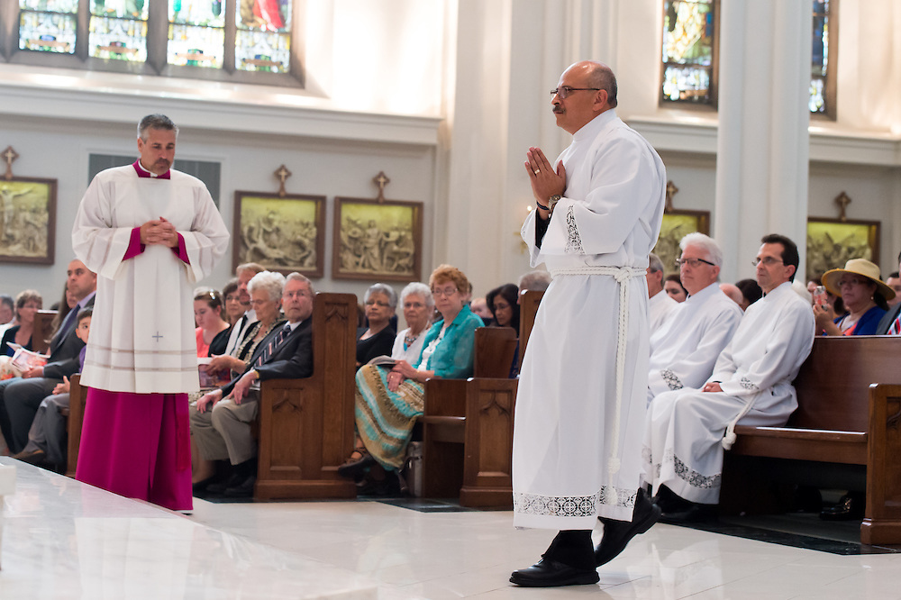 DENVER, CO - JUNE 20: Efrain Pruneda walks toward the sanctuary during the deacon ordination for the Archdiocese of Denver at the Cathedral Basilica of the Immaculate Conception on June 20, 2015, in Denver, Colorado. (Photo by Anya Semenoff/Denver Catholic)