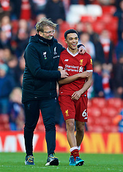 LIVERPOOL, ENGLAND - Saturday, February 24, 2018: Liverpool's manager Jürgen Klopp celebrates the 4-1 victory over West Ham United with Trent Alexander-Arnold after the FA Premier League match between Liverpool FC and West Ham United FC at Anfield. (Pic by David Rawcliffe/Propaganda)