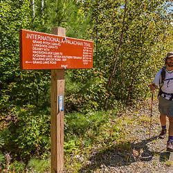 A man hikes the International Appalachian Trail east of Baxter State Park in Maine's northern forest.