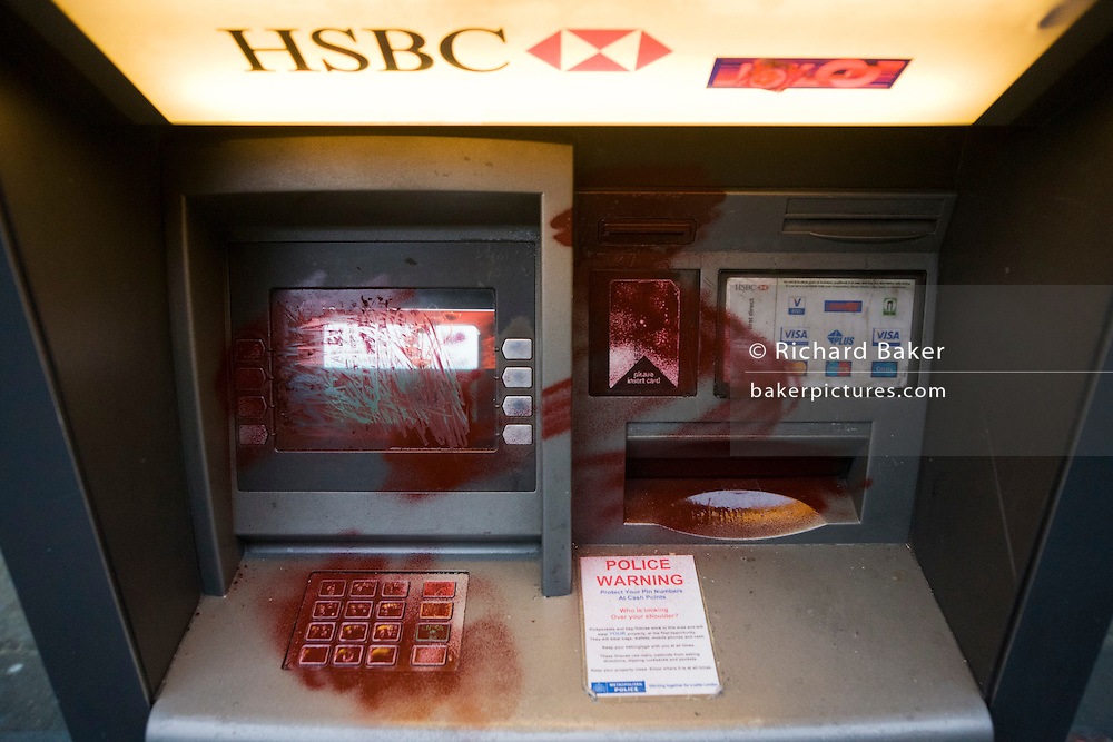 Vandalism by breakaway anarchists to HSBC bank dispenser the morning after the TUC-organised anti-government march against cuts to Britain's economy.