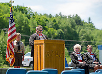 Elks Exalted Ruler Jim Culpon addresses those gathered for Flag Day ceremonies with Adam Barton Boy Scout Troup 68, Leading Knight Jan Dignan and Lecturing Knight Margaret Mary Culpon on Sunday morning.  (Karen Bobotas/for the Laconia Daily Sun)