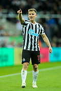 Matt Ritchie (#11) of Newcastle United indicates the he feels a Watford free kick should be moved back during the Premier League match between Newcastle United and Watford at St. James's Park, Newcastle, England on 3 November 2018.