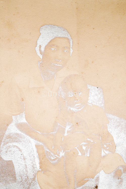 fading silverized image of mother with baby toddler Japan ca 1940s