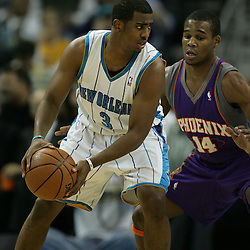 03 December 2008:  New Orleans Hornets guard Chris Paul (3) is defended by Phoenix Suns guard Sean Singletary (14) during the first half of a NBA regular season game between the Phoenix Suns and the New Orleans Hornets at the New Orleans Arena in New Orleans, LA..