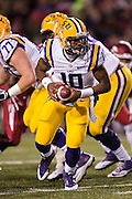 FAYETTEVILLE, AR - NOVEMBER 15:  Anthony Jennings #10 of the LSU Tigers turns to make a hand off during the second quarter of a game against the Arkansas Razorbacks at Razorback Stadium on November 15, 2014 in Fayetteville, Arkansas.  The Razorbacks defeated the Tigers 17-0.  (Photo by Wesley Hitt/Getty Images) *** Local Caption *** Anthony Jennings
