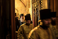 Monks and deacons enter during the Brethren service at the Church of the Exaltation of the Cross at the Kyiv-Pechersk Lavra on Saturday, October 6, 2018 in Kyiv, Ukraine.