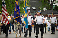 Members of VFW Post 33 lead the parade route up Main Street to the Meredith Public Library with a stop at the Lang Cemetery and Hesky Park for Memorial Day services on Monday morning.  (Karen Bobotas/for the Laconia Daily Sun)