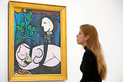 """UNITED KINGDOM, London: 06 March 2018 A visitor takes a look at Picasso's """"Nude, Green Leaves and Bust"""" at The Tate Modern's new exhibition 'Picasso 1932: Love, Fame, Tragedy'. The exhibition, which consists of a wide range of Picasso works, runs from 8th March - 9 September 2018.  Rick Findler / Story Picture Agency"""