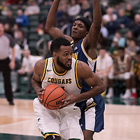 5th year forward Brian Ofori (11) of the Regina Cougars in action during the Men's Basketball home game on January  19 at Centre for Kinesiology, Health and Sport. Credit: Arthur Ward/Arthur Images