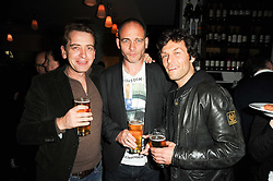 Left to right, SCOTT DOUGLAS, DINOS CHAPMAN and BARRY REIGATE at a party to celebrate the 10th anniversary of Counter Editions the contemporary art website held at Rivington Grill, Shoreditch, London on 5th May 2010.
