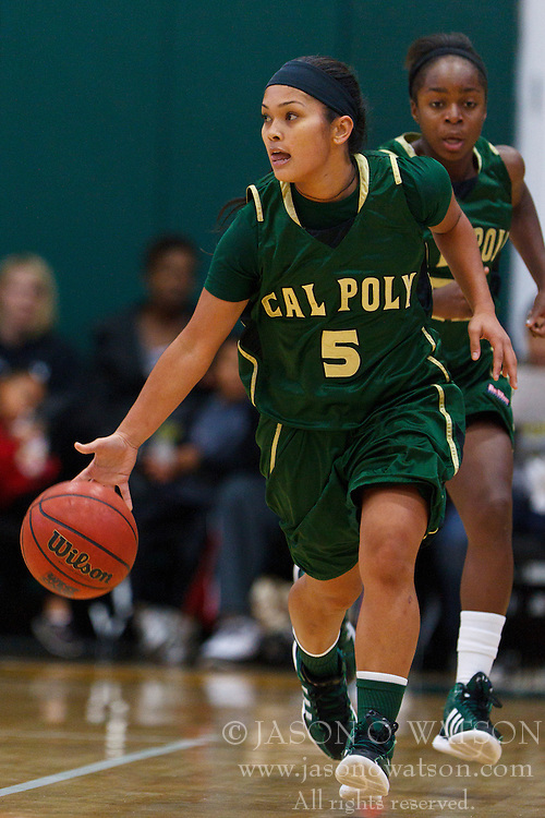 Nov 16, 2011; San Francisco CA, USA;  Cal Poly Mustangs guard Ariana Elegado (5) dribbles the ball up court against the San Francisco Lady Dons during the first half at War Memorial Gym.  Cal Poly defeated San Francisco 80-66. Mandatory Credit: Jason O. Watson-US PRESSWIRE