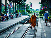 31 MAY 2017 - CHACHOENGSAO, THAILAND: A Buddhist monk walks into the train station in Chachoengsao, a provincial town about 50 miles and about an hour by train from Bangkok. The train from Chachoengsao to Bangkok takes a little over an hour but traffic on the roads is so bad that the same drive can take two to three hours. Thousands of Thais live outside of Bangkok and commute into the city for work on trains, busses and boats.      PHOTO BY JACK KURTZ