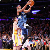 10 November 2013: Minnesota Timberwolves small forward Corey Brewer (13) goes for the layup past Los Angeles Lakers point guard Steve Nash (10) during the Minnesota Timberwolves 113-90 victory over the Los Angeles Lakers at the Staples Center, Los Angeles, California, USA.