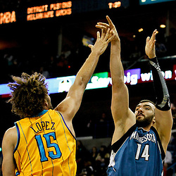 Jan 11, 2013; New Orleans, LA, USA; Minnesota Timberwolves center Nikola Pekovic (14) shoots over New Orleans Hornets center Robin Lopez (15) during the first quarter of a game at the New Orleans Arena. Mandatory Credit: Derick E. Hingle-USA TODAY Sports
