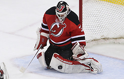 May 6, 2012; Newark, NJ, USA; New Jersey Devils goalie Martin Brodeur (30) makes a save during the first period in game four of the 2012 Eastern Conference semifinals at the Prudential Center.