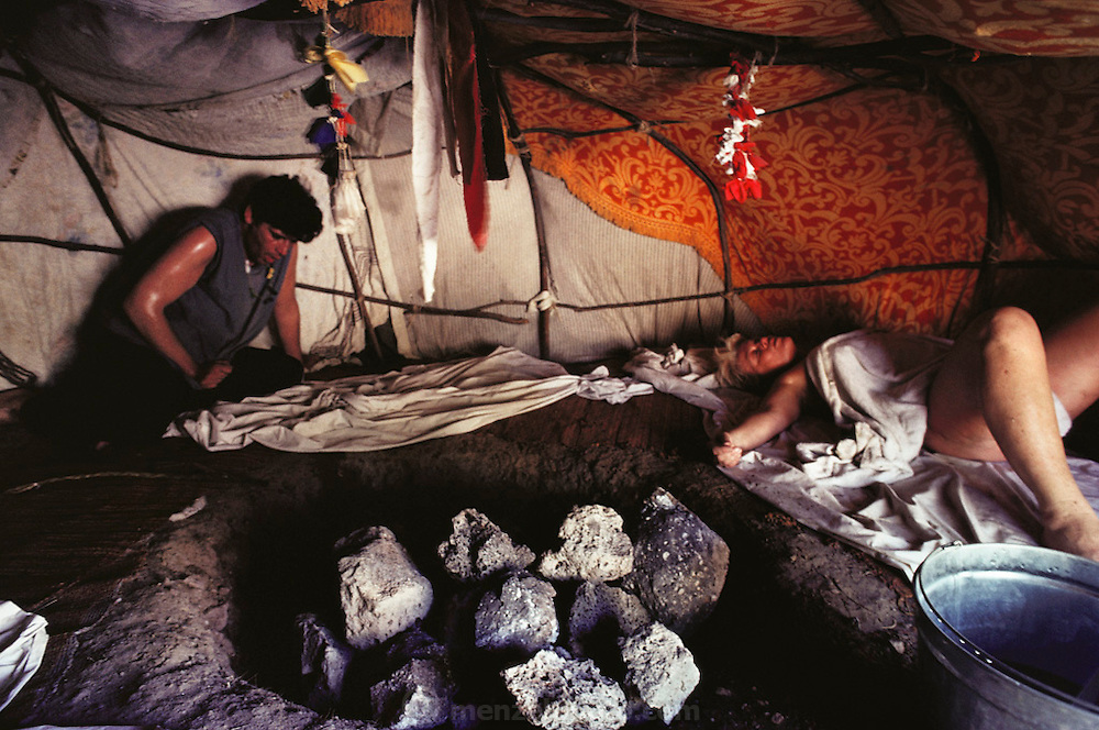 River's sweat lodge, with hot rocks, steam, beating drum. Shot for a New Age story written by Bernard Zekri (left, gasping for breath) for Actuel Magazine, France. Santa Fe, New Mexico, USA. .MODEL RELEASED.