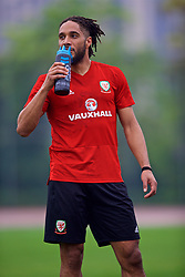 NANNING, CHINA - Saturday, March 24, 2018: Wales' captain Ashley Williams drinks from a PAS bottle during a training session at the Guangxi Sports Centre ahead of the 2018 Gree China Cup International Football Championship final match against Uruguay. (Pic by David Rawcliffe/Propaganda)