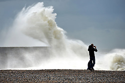 © Licenced to London News Pictures. 06-06-17. Newhaven, East Sussex. The first summer storm of 2017 batters the lighthouse at Newhaven, on the Sussex coast. Despite the dangers members of the public get close to try photograph it. Photo credit: Peter Cripps/LNP
