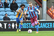 Matt Tootle of Shrewsbury Town and Scott Wiseman of Scunthorpe Unitedduring the Sky Bet League 1 match between Scunthorpe United and Shrewsbury Town at Glanford Park, Scunthorpe, England on 17 October 2015. Photo by Ian Lyall.