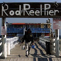 (02.02.2005)(PHOTO/CHIP LITHERLAND) -- Greg Nulty, a seasonal resident of Anna Maria from Otsego, Mich., heads home after three hours of fishing at the Rod & Reel Pier on Anna Maria Island Wednesday morning.
