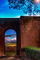 """Evening view through the arch of the ancient Orvieto Etruscan walls and vineyards below""...<br />
