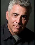 Studio headshot of actor/director Adam Arkin