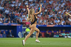 MADRID, SPAIN - SATURDAY, JUNE 1, 2019: A female pitch invader runs onto the field during the UEFA Champions League Final match between Tottenham Hotspur FC and Liverpool FC at the Estadio Metropolitano. (Pic by David Rawcliffe/Propaganda)
