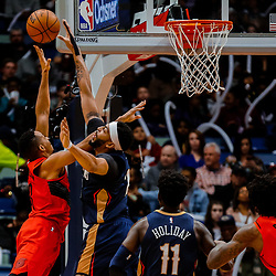 Jan 12, 2018; New Orleans, LA, USA; New Orleans Pelicans forward Anthony Davis (23) blocks a shot byPortland Trail Blazers guard CJ McCollum (3) during the first quarter at the Smoothie King Center. Mandatory Credit: Derick E. Hingle-USA TODAY Sports