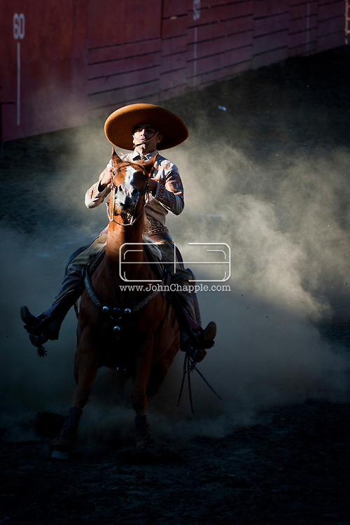 October 1st, 2011. Pico Rivera, California. Traditional charros (Mexican cowboys) compete in a Mexican Rodeo. The competition at the Pico Rivera Sports Arena is a display of horsemanship and lasso skills. Pictured is Leonardo Lopez Jr. sliding his horse..PHOTO © JOHN CHAPPLE / www.johnchapple.com