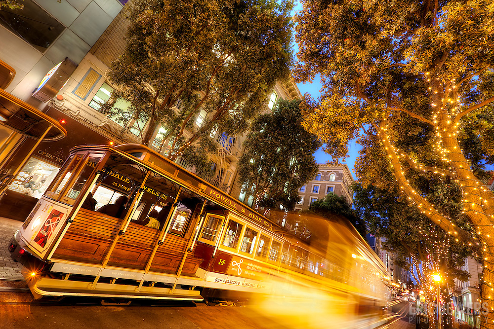 Streetcar motion blur and traffic at dusk along Powell Street near Ellis, downtown San Francisco, CA.