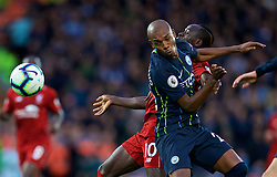 LIVERPOOL, ENGLAND - Sunday, October 7, 2018: Liverpool's Sadio Mane is clattered into by Manchester City's Fernando Luiz Roza 'Fernandinho' (L) during the FA Premier League match between Liverpool FC and Manchester City FC at Anfield. (Pic by David Rawcliffe/Propaganda)