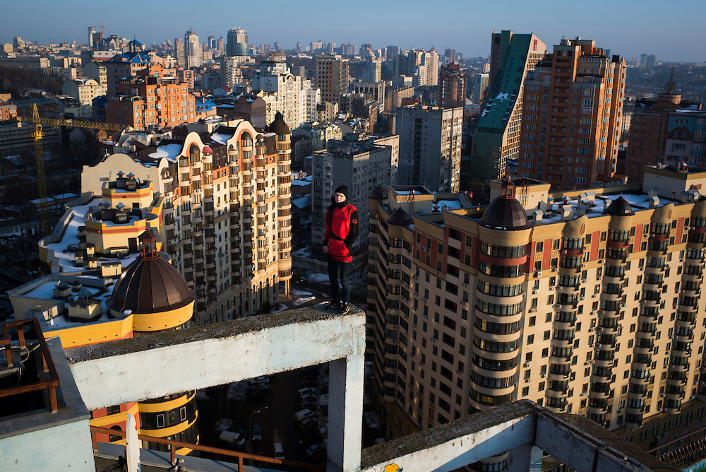 Extreme climber Mustang Wanted poses for a portrait on a ledge on the roof of a 26-storey building on February 19, 2017 in the Shevchenkovski District of Kiev, Ukraine.