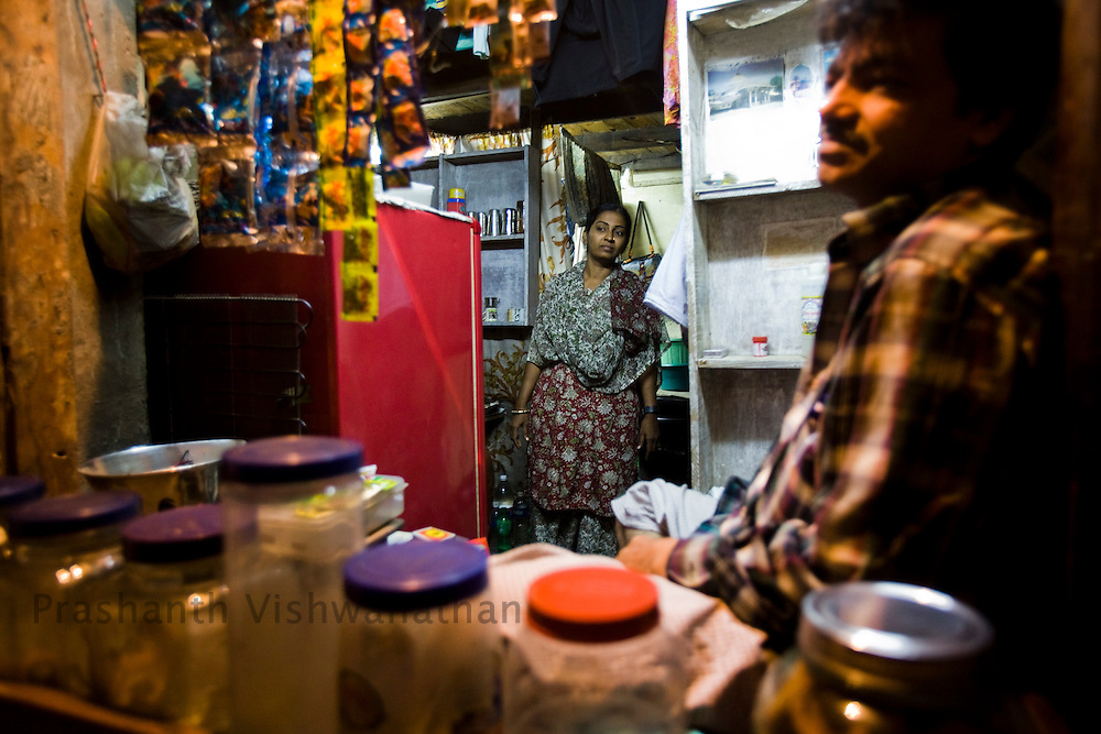 Suraaiya and her husband share their room and their shop in the front of her house in Razzaq chawl in Behrampada, in Mumbai, India, on Monday February 10, 2009.Surraiya is a WRAG staff and an active  leader in the women self help groups.