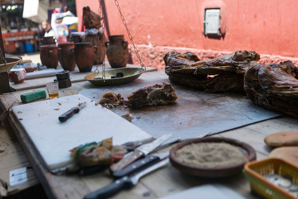 MARRAKESH, MOROCCO - April 30 2018 - Traditional mechoui - slow roasted lamb is served up daily at 'mechoui alley' in Marrakech, Morocco. <br />