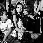 Pre-teens and professional models wait backstage before hitting the catwalk at a fashion show in Hanoi, Vietnam. With government-instituted market reforms and a rapidly growing economy, young urban Vietnamese now have more disposable income to spend on mobile phones, slick motorbikes and up-to-date fashions. YEAR: 2004
