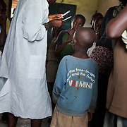 Volunteer Doofan read the outcome of a speed test on one of the 120 children at the HCT session. All 120 children turned out to be negative.  EVA provide HCT in three rural communities near Makurdi in Benue state. Benue state has got one of the highest HIV prevalence in Nigeria and EVA aim to target vulnerable children who would otherwise miss out of being tested for HIV and therefor not know their HIV statues.  Education As a Vaccine Against Aids (EVA) in Nigeria.