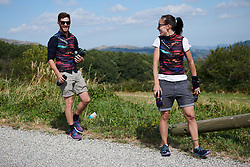 CANYON//SRAM Racing soigneur, Alessandra Borchi and CANYON//SRAM Racing Physiotherapist, Lars Schiffner wait in the feed zone at Tour Cycliste Féminin International de l'Ardèche 2018 - Stage 7, a 90.9km road race from Chomerac to Privas, France on September 18, 2018. Photo by Sean Robinson/velofocus.com