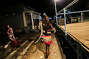 A transvestite bring snakes as she dance during the folkfore show in Mojokerto, East Java, Indonesia, June 7, 2015.