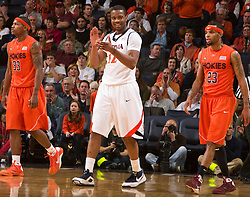 Virginia forward Jamil Tucker (12) applauds a play against VT.  The Virginia Cavaliers defeated the Virginia Tech Hokies 75-61 at the John Paul Jones Arena on the Grounds of the University of Virginia in Charlottesville, VA on February 18, 2009.