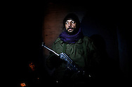 SYRIA - Al Qsair. A member of Free Syrian Army stands guard at night in Al Qsair, on January 23, 2012. Al Qsair is a small town of 40000 inhabitants, located 25Km south-west of Homs. The town is besieged since the beginning of November and so far it counts 65 dead. ALESSIO ROMENZI